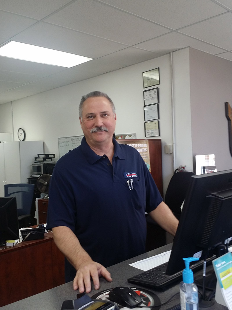 Auto Repair Shop Owner- Dan at Counter